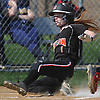 Molly Cummings #1, Babylon catcher, slides home safely in the bottom of the first inning of a Suffolk League VII varsity softball game against Shoreham-Wading River at Babylon Elementary School on Tuesday, May 1, 2018. Babylon won by a score of 13-1.