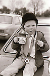 Enjoying tea and biscuits at the showjumping - 1983. Photograph by Liam McGrath