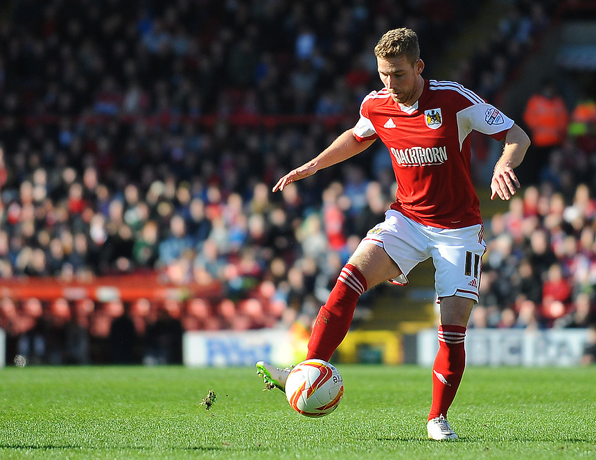 Bristol City's Scott Wagstaff in action during todays match  <br /> <br /> Photo by Kevin Barnes/CameraSport<br /> <br /> Football - The Football League Sky Bet League One - Bristol City v Swindon Town - Saturday 15th March 2014 - Ashton Gate - Bristol<br /> <br /> &copy; CameraSport - 43 Linden Ave. Countesthorpe. Leicester. England. LE8 5PG - Tel: +44 (0) 116 277 4147 - admin@camerasport.com - www.camerasport.com