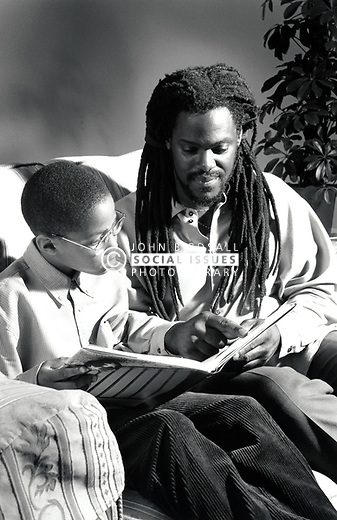 Father reading with his son UK 1990s