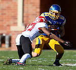 BROOKINGS, SD - OCTOBER 25:  Matt Raymond #81 from South Dakota State University tries to make a move against Nate Dortch #27 from Youngstown State in the second quarter of their game Saturday afternoon at Coughlin Alumni Stadium in Brookings. (Photo by Dave Eggen/Inertia)