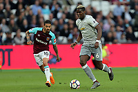 Paul Pogba of Manchester United and Manuel Lanzini of West Ham United during West Ham United vs Manchester United, Premier League Football at The London Stadium on 10th May 2018