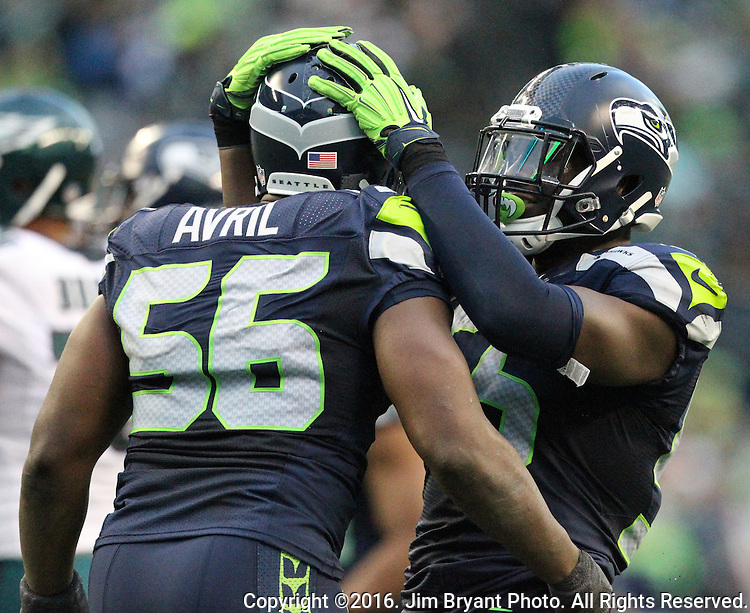 Seattle Seahawks defensive end Frank Clark (55) celebrates a fumble caused by Seattle Seahawks defensive end Cliff Avril (56) against the  Philadelphia Eagles at CenturyLink Field in Seattle, Washington on November 20, 2016.  Seahawks beat the Eagles 26-15.  ©2016. Jim Bryant Photo. All Rights Reserved.