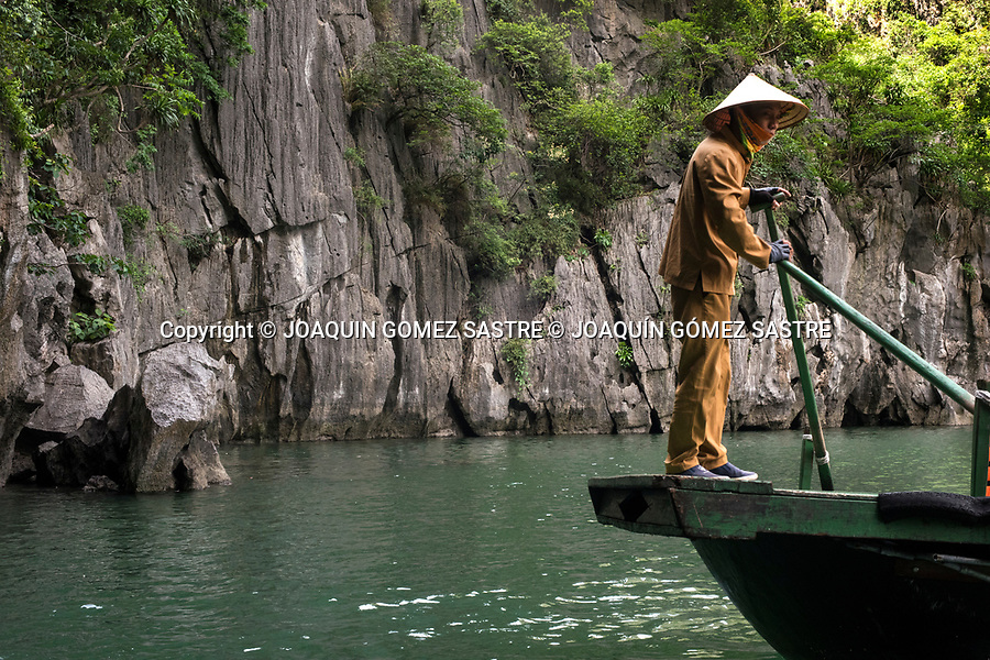 A man drives his boat through Halong Bay, considered a UNESCO World Heritage Site.<br /> HALONG-VIETNAM