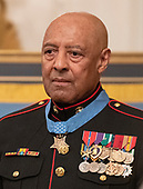 Sergeant Major John L. Canley, United States Marine Corps (Retired) wears his medal at the conclusion of the ceremony where US President Donald J. Trump awarded him the Medal of Honor for conspicuous gallantry during the Vietnam War in a ceremony in the East Room of the the White House in Washington, DC on Wednesday, October 17, 2018.<br /> Credit: Ron Sachs / CNP
