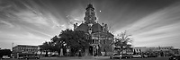 Monochrome panoramic view of historical Ellis County Courthouse and city square in Waxahachie, Texas.