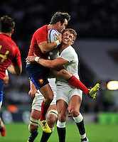 Morgan Parra of France is tackled by Henry Slade of England in the air. QBE International match between England and France on August 15, 2015 at Twickenham Stadium in London, England. Photo by: Patrick Khachfe / Onside Images