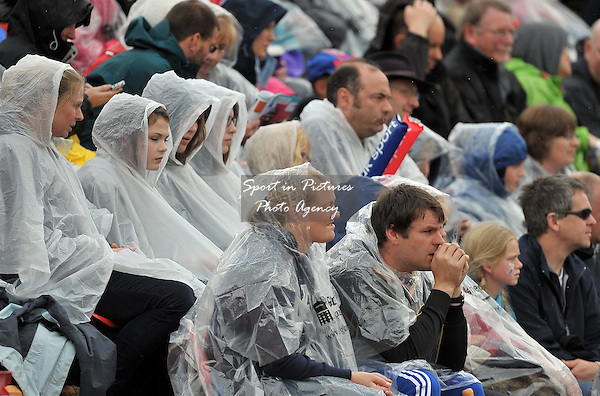 It's a good day for a poncho as the rain falls in Gateshead.  Day 2. European Team Athletics Championships. Gateshead. Tyne and Wear. UK. 23/06/2013. <br />  MANDATORY Credit Garry Bowden/SIPPA - NO UNAUTHORISED USE - 07837 394578