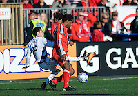 11 April 2009:  Toronto FC defender Adrian Serioux #15 and FC Dallas midfielder Eric Avila #12 in action during an MLS game at BMO Field in Toronto between FC Dallas and Toronto FC. The game ended in a 1-1 draw.