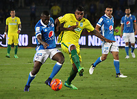 BOGOTA -COLOMBIA, 7-06-2017. Duvier Riascos player of Millonarios fights the ball  agaisnt of  Elkin Blanco player of Atletico Nacional .Action game between  Millonarios  and Atletico Nacional during match for quarter finals of the Aguila League I 2017 played at Nemesio Camacho El Campin stadium . Photo:VizzorImage / Felipe Caicedo  / Staff