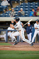 West Michigan Whitecaps left fielder Cam Gibson (23) follows through on a swing during a game against the Clinton LumberKings on May 3, 2017 at Fifth Third Ballpark in Comstock Park, Michigan.  West Michigan defeated Clinton 3-2.  (Mike Janes/Four Seam Images)