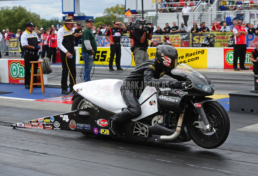 Sept. 18, 2011; Concord, NC, USA: NHRA pro stock motorcycle rider Matt Smith during the O'Reilly Auto Parts Nationals at zMax Dragway. Mandatory Credit: Mark J. Rebilas-