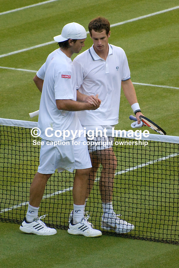 Andy Murray, UK, seeded 3, right, commiserates with his defeated opponent, Robert Kendrick, USA, unseeded, who he met in the first round of the men's singles at the Wimbledon Tennis Championships. 200906232739..Copyright Image from Victor Patterson, 54 Dorchester Park, Belfast, UK, BT9 6RJ..Tel: +44 28 9066 1296.Mob: +44 7802 353836.Voicemail +44 20 8816 7153.Skype: victorpattersonbelfast.Email: victorpatterson@mac.com.Email: victorpatterson@ireland.com (back-up)..IMPORTANT: If you wish to use this image or any other of my images please go to www.victorpatterson.com and click on the Terms & Conditions. Then contact me by email or phone with the reference number(s) of the image(s) concerned.