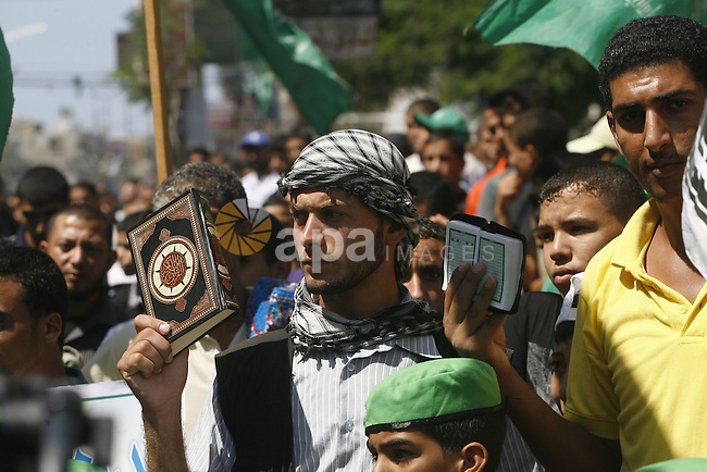 Palestinians hold placards as they shout anti-U.S. slogans during a demonstration against the controversial film 'Innocence of Muslims' in Rafah southern Gaza strip, on September 14, 2012. The controversial low budget film reportedly made by an Israeli-American which portrays Muslims as immoral and gratuitous, sparked fury in Libya, where four Americans including the ambassador were killed on Tuesday when a mob attacked the US consulate in Benghazi, and has led to protests outside US missions in Morocco, Sudan, Egypt, Tunisia and Yemen. Photo by Eyad Al Baba
