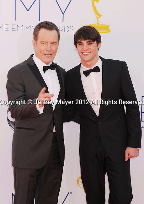 LOS ANGELES, CA - SEPTEMBER 23: Bryan Cranston and RJ Mitte arrive at the 64th Primetime Emmy Awards at Nokia Theatre L.A. Live on September 23, 2012 in Los Angeles, California.
