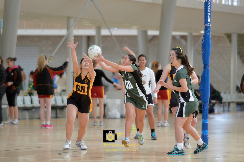 Action from the College Netball - CSW Premier Netball Tournament  at ASB Sports Centre, Kilbirnie, Wellington, New Zealand on Thursday 22 May 2014. <br /> Photo by Masanori Udagawa. <br /> www.photowellington.photoshelter.com.