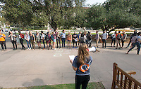 Lauren Breynaert '16 talks through a bull horn. Occidental College students march in a rally organized by Fossil Free Occidental on Nov. 14, 2014. The group hopes to end Oxy's reliance on fossil fuels by freezing all investments in the 200 largest fossil-fuel companies (measured by their proven carbon reserves in oil, gas or coal) and over the next five to ten years sell the stock in these same companies, and then reinvest 5%, at minimum, of the divested portfolio in socially responsible investments. (Photo by Marc Campos, Occidental College Photographer)