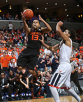 Miami guard Angel Rodriguez (13) shoots next  during the game Tuesday, Jan. 12, 2016 in Charlottesville, Va. Virginia defeated Miami 66-58. Photo/Andrew Shurtleff