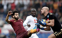 Roma&rsquo;s Mohamed Salah, left, is stopped by Napoli&rsquo;s goalkeeper Pepe Reina, right, as defender Kalidou Koulibaly, center, looks on during the Italian Serie A football match between Roma and Napoli at Rome's Olympic stadium, 4 March 2017. <br /> UPDATE IMAGES PRESS/Isabella Bonotto