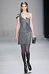 Samantha Gradoville walks the runway in a Nicole Miller Fall 2011 outfit, during Mercedes-Benz Fashion Week.