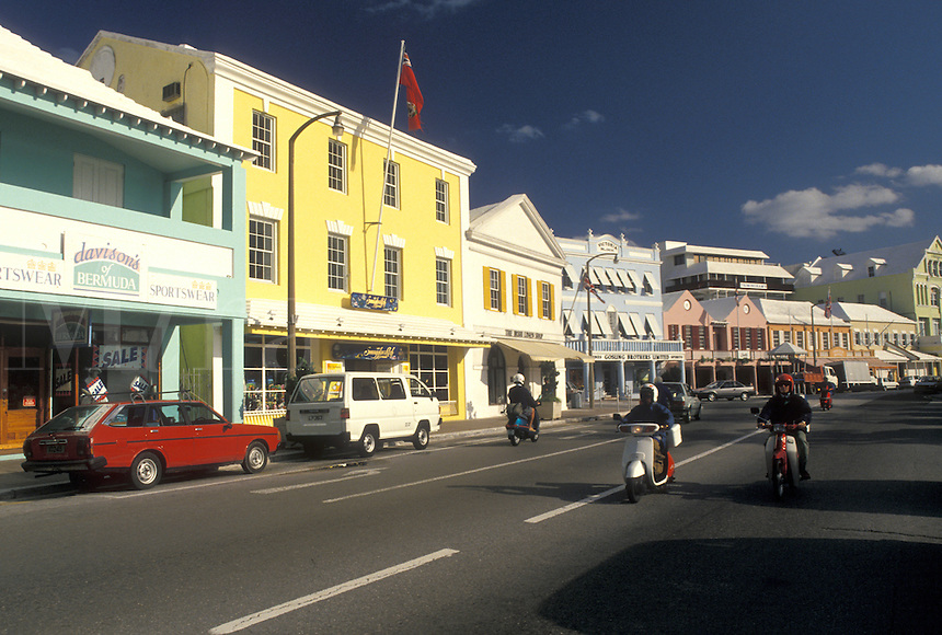 Bermuda, Hamilton, People driving mopeds along Front Street in the town of Hamilton in Bermuda.