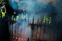 Riot police are seen behind a haze of smoke as thousands of protestors descended on the City of London ahead of the G20 summit of world leaders to express anger at the economic crisis, which many blame on the excesses of capitalism.