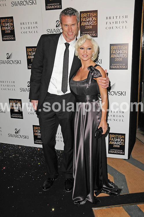 **ALL ROUND PICTURES FROM SOLARPIX.COM**.**WORLDWIDE SYNDICATION RIGHTS**.inside arrivals for the British Fashion Awards, held at the Royal Horticultural Hall, London, UK. 25th November 2008..This pic: Kristina Rihanoff and Mark Foster..JOB REF: 7356 MSR     DATE: 25_11_2008.**MUST CREDIT SOLARPIX.COM OR DOUBLE FEE WILL BE CHARGED* *UNDER NO CIRCUMSTANCES IS THIS IMAGE TO BE REPRODUCED FOR ANY ONLINE EDITION WITHOUT PRIOR PERMISSION*