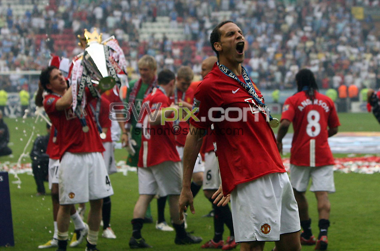PICTURE BY Ben Duffy/SWPIX.COM -Premier League Football, Wigan Athletic v Manchester United....11/05/08. ..Copyright - Simon Wilkinson - 07811267706..Manchester United's Rio Ferdinand celebrates winning the title after victory at Wigan