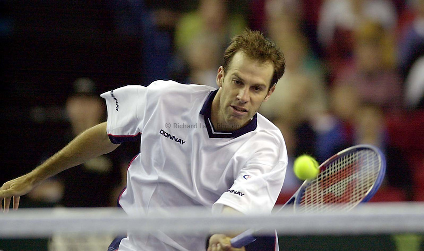 Photo:Ken Brown .6.4.2001 Davis Cup Great Britain v Portugal.Greg Rusedski v Emanuel Couto.Greg volleys a winner in the final game of the match