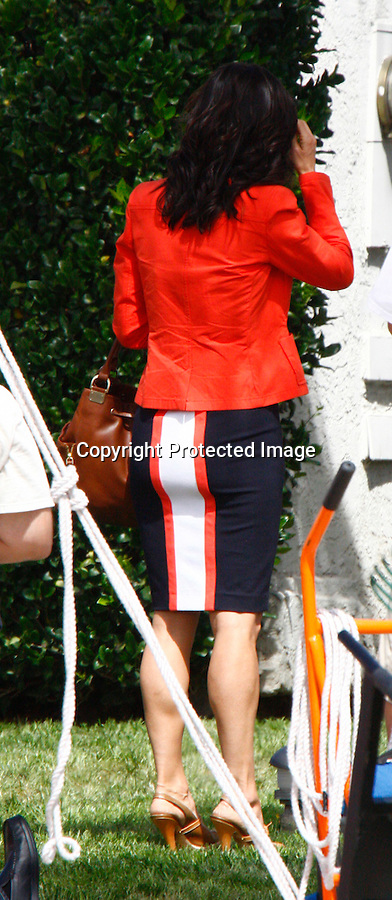 3-26-09.Courteney  Cox filming a chase scene & fight scene for her new tv pilot called Cougar Town in Los Angeles ca.  Busy Philipps was also in the scene. It was very windy that day blowing hair ..AbilityFilms@yahoo.com.805-427-3519.www.AbilityFilms.com