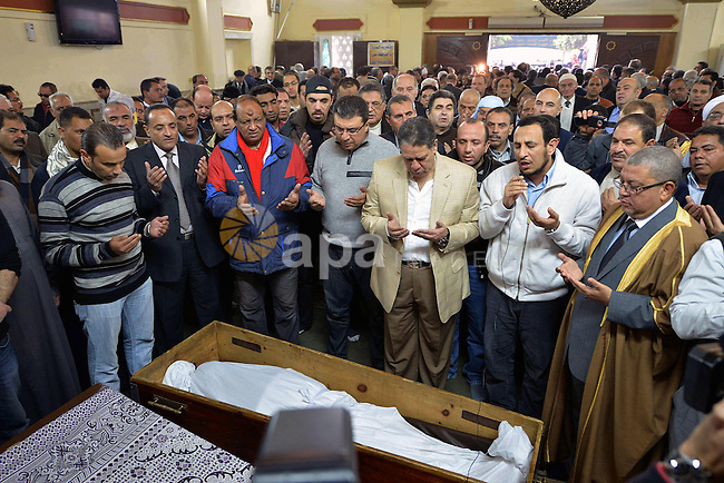 Egyptian mourners pray over the coffin of Mamdouh el-Leithi during his funeral in Cairo on January 1, 2014. Prominent producer and scenarist Mamdouh el-Leithi passed away on Wednesday  morning at the age of 77. Photo by Mohammed Bendari