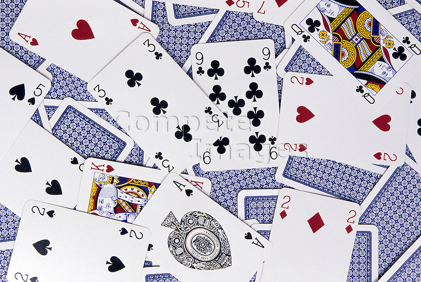 Playing cards scattered on a surface