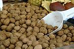 Walnuts displayed for sale on market stall. Viktualienmarkt, Munich, Germany.