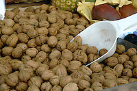 Walnuts displayed for sale on market stall. Viktualienmarkt, Munich, Germany.