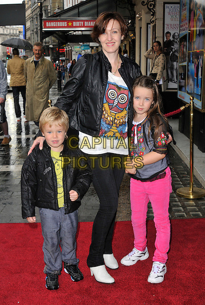 Kacey Ainsworth & her kids.The 'Nickelodeon's Dora the Explorer LIVE! Search for the City of Lost Toys' press performance, Apollo Theatre, Shaftesbury Avenue, London, England..August 29th, 2012.full length black leather jacket white top print pink jeans denim grey gray trousers children family mother mom mum family  .CAP/WIZ.© Wizard/Capital Pictures.