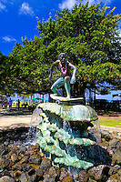 A Surfer statue/fountain stands as a tribute to surfings contribution to the allure of Hawaii. This statue can be seen along Kalakaua ave.near Waikiki Beach.
