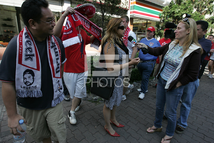 f2d2b4d29f United States fans marching to Azteca stadium from the Zona Rosa District  of Mexico City walk