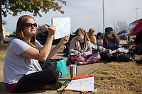 NWA Democrat-Gazette/CHARLIE KAIJO Math teacher Meredith Davis gives a lesson to her class outside Burns Hall following a fire alarm on Thursday, November 9, 2017 at Northwest Arkansas Community College in Bentonville. Students and faculty evacuated Burns Hall around noon after a fire alarm went off. The cause of the fire was burnt popcorn in the third floor. Davis and her students decided to continue their lesson outside because it was a nice day once students and faculty were allowed back into the building.