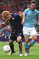 Men's Olympic Football match Spain v Japan on 26.7.12...Hiroki Sakai of Japan and Lopez Adrian of Spain, during the Spain v Japan Men's Olympic Football match at Hampden Park, Glasgow.........