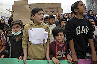 Pictured: Children take part in the protest Tuesday 08 March 2016<br /> Re: Afghan migrants hold a protest at Piraeus port, near Athens, Greece.