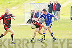 Kenmare's Sean O'Leary and Ballymac's Shane Dowling in action in the junior county championship quarter final at Ballymac on Sunday.
