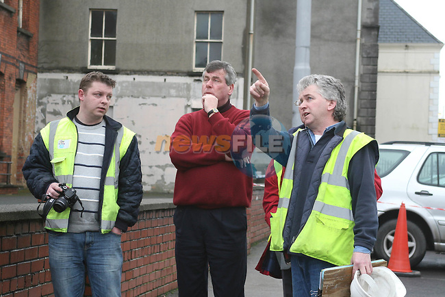 .Corporation of Drogheda Housing and Planning Section which was destroyed by fire last night.  A technical exaimination will take place to determine the cause of the fire.  AIDAN O ROURKE, DROGHEDA BOROUGH COUNCIL PLANNING OFFICES (centre) AND John Walsh (right) (right) discuss how to make the remains safe..Photo NEWSFILE/Jenny Matthews.(Photo credit should read Jenny Matthews/NEWSFILE)....This Picture has been sent you under the condtions enclosed by:.Newsfile Ltd..The Studio,.Millmount Abbey,.Drogheda,.Co Meath..Ireland..Tel: +353(0)41-9871240.Fax: +353(0)41-9871260.GSM: +353(0)86-2500958.email: pictures@newsfile.ie.www.newsfile.ie.FTP: 193.120.102.198.