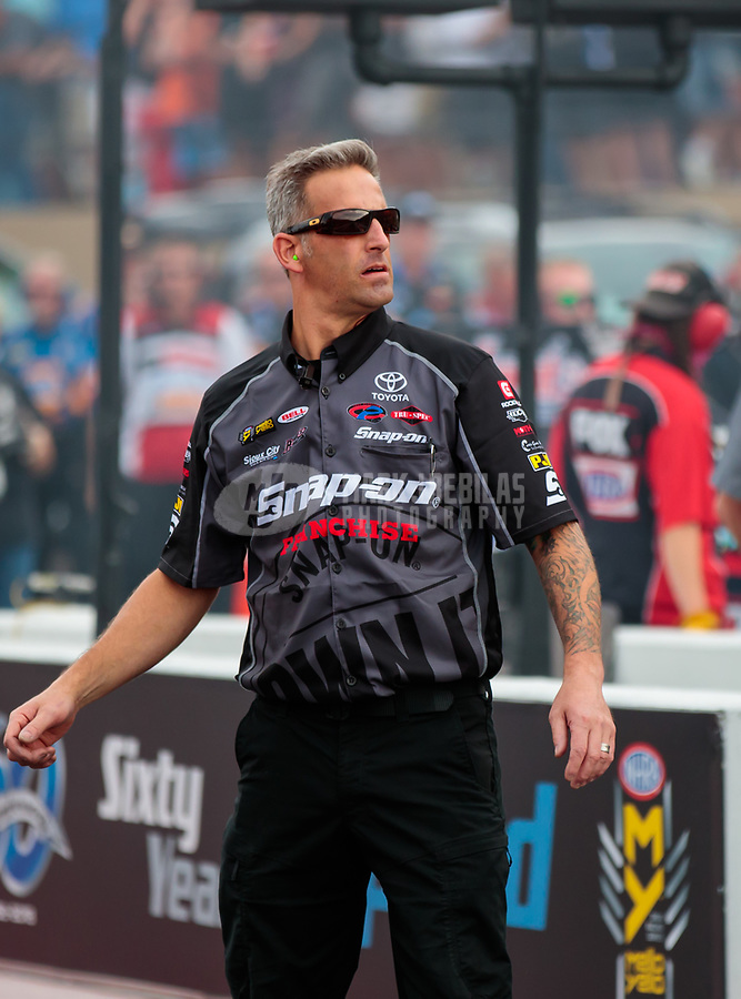 Jul 20, 2018; Morrison, CO, USA; Aaron Brooks, crew chief for NHRA funny car driver Cruz Pedregon during qualifying for the Mile High Nationals at Bandimere Speedway. Mandatory Credit: Mark J. Rebilas-USA TODAY Sports