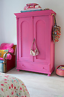 The fuchsia pink wardrobe in the bedroom is from a second hand shop and has been painted with wall-paint to create a chalky hue
