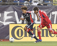 New England Revolution defender Kevin Alston (30) brings the ball forward as Chicago Fire defender Gonzalo Segares (13) closes. In a Major League Soccer (MLS) match, the New England Revolution defeated Chicago Fire, 2-0, at Gillette Stadium on June 2, 2012.