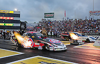 Jun. 1, 2012; Englishtown, NJ, USA: NHRA funny car driver Tony Pedregon (near lane) races alongside Tim Wilkersonduring qualifying for the Supernationals at Raceway Park. Mandatory Credit: Mark J. Rebilas-