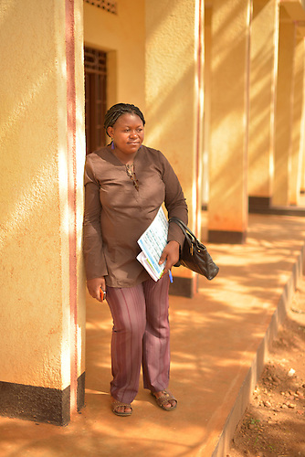 Jeannette Uwingabiye, supervisor of community health workers at Ruhunda Health Center, Rwanda...She is standing outside a building the health workers use to store grain for sale......