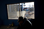 A man who recently crossed illegally to the United States and was returned to Mexico by the Border Patrol makes a phone call at the Migrant Resource Center in Naco, Sonora, Mexico, on Wednesday, Jan. 30, 2008. The Migrant Resource Center is a bi-national project of Citizens for Border Solutions (Bisbee, AZ) and Iglesia del Camino (Naco, Mexico), with support from other organizations and individuals.