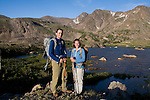 couple, portrait, (MR), hike, alpine, tundra, pristine, back country, Rowe Mountain, Rowe Peak distant, high elevation, recreation, outdoors, activity, August, summer, morning, Rocky Mountain National Park, Colorado, USA