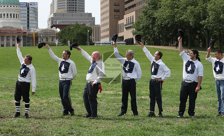 "Lafayette Cyclone BBC (base ball club) players tip their caps and yell ""Huzzah"" as part of their tribute to the Belleville Stags following their Saturday August 18 game under the Gateway Arch on the St. Louis riverfront."